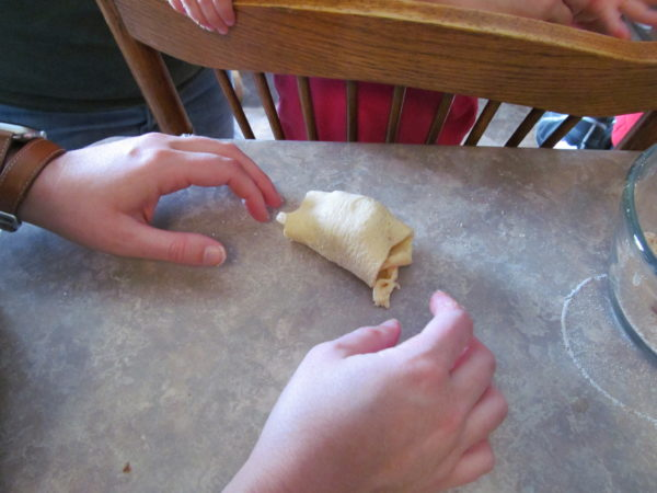 Wrapping the marshmallow in the Resurrection Crescent Roll.