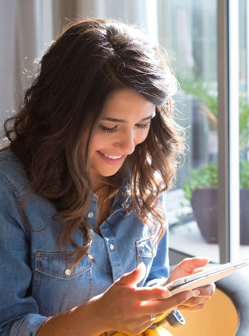 woman using tablet to watch Christian women's conference