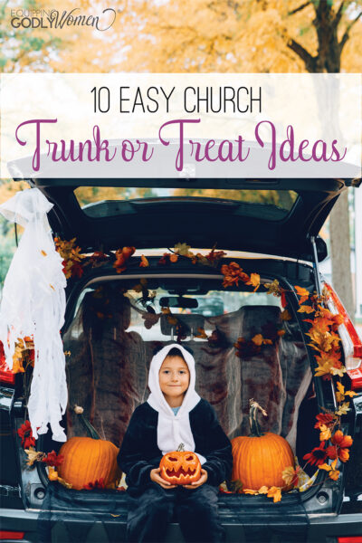 Two children sitting in a trunk decorated with church trunk or treat ideas for Halloween